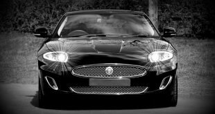 Grayscale Photo of a Black Sports Car Convertible Wallpaper