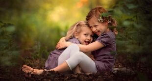 Two cute little sisters playing in the park HD Wallpapers